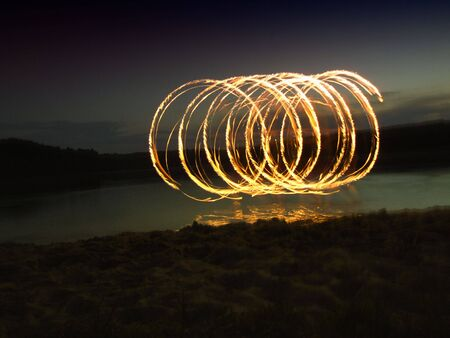 poi: fire show with poi Stock Photo