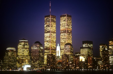 New York City skyline with the World Trade Center towers at night. Horizontal shot.