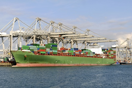 container ship in the harbor of rotterdam netherlands photo