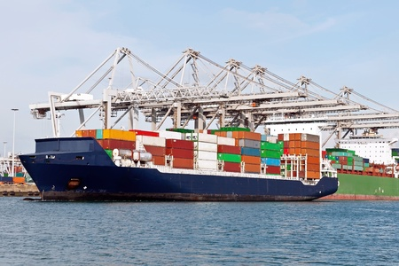 container ship in the harbor of rotterdam netherlands Stock Photo