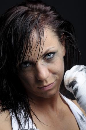 female fighter on black background photo