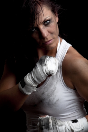 young female fighter ready for boxing  photo