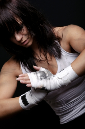 martial arts woman: young female fighter ready for boxing