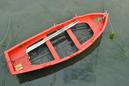 rowing boat: old colorful rowing boat in Spain Stock Photo