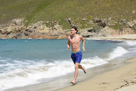 young athlete running on the beach
