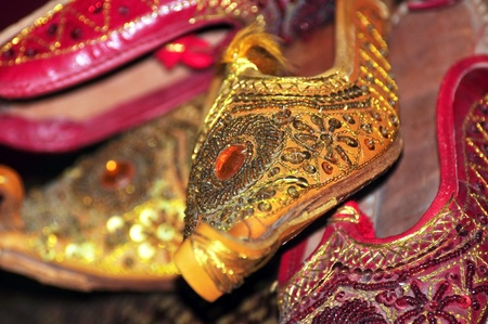 gold souk: red and gold arabic shoes Stock Photo