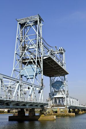 get across: Botlek bridge in rotterdam Netherlands lifting to allow ships get across