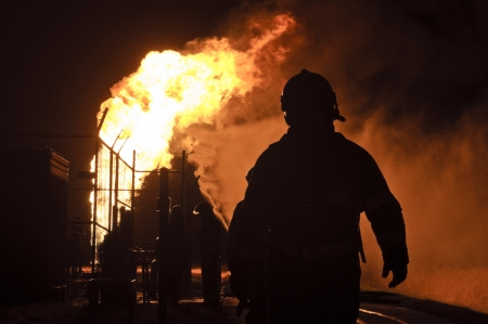 fire department: firefighters in action after a gas explosion