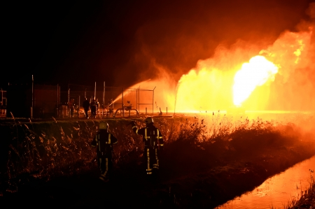 firefighters in action after a gas explosion  photo