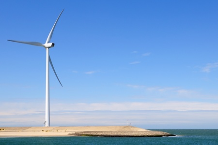 wind turbine on coastline photo