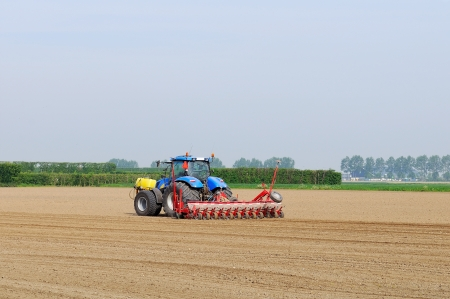 tractor plowing the field photo