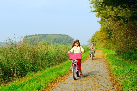 Children enjoying nature on bicycle Stock Photo
