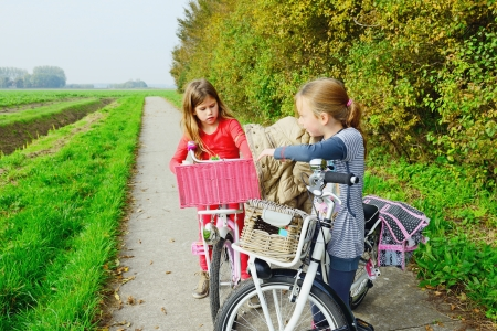 Children enjoying nature on bicycle photo