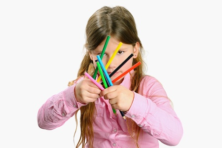 girl with color pencils in her hand photo