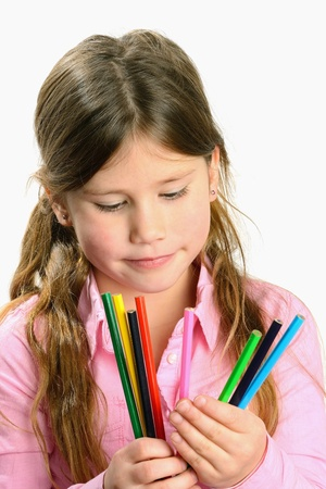 child looking at color pencils photo