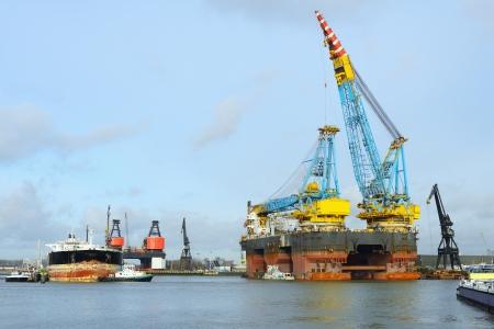 crane vessel and oil tanker Stock Photo