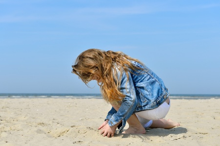 child playing on the beach  photo