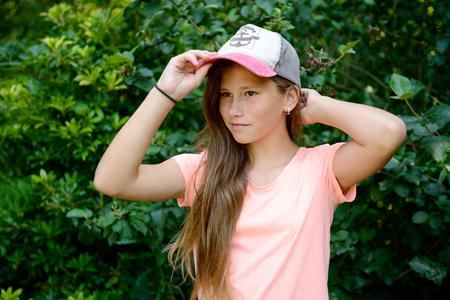 school girl with baseball cap Stock Photo