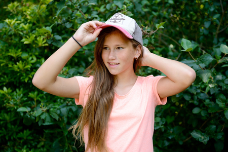 happy young girl with baseball cap