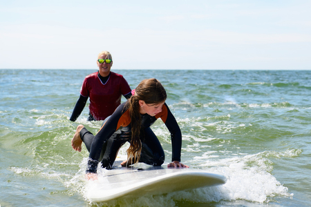 young girl have surf lessons on vacation
