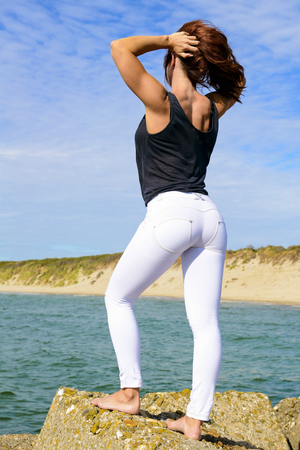 Girl with skinny white pushup pants
