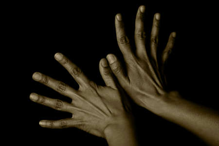 Two hands with black background.