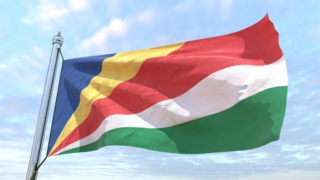 Flag of the country Seychelles weaving in the air. Flying in the sky.