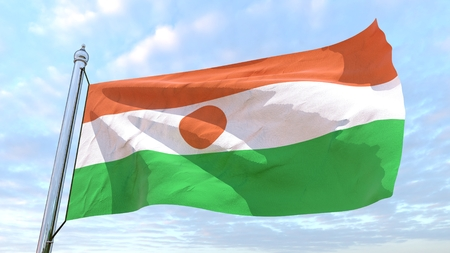 Flag of the country Niger weaving in the air. Flying in the sky. Stock Photo
