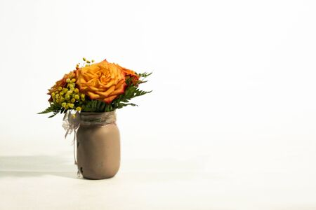 Yellow rose flowers arrangement isolated on white