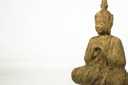 Buddha statue made of wood white background