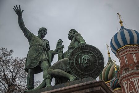 minin: MOSCOW, RUSSIA - FEBRUARY 15, 2014: Monument to Minin and Pozharsky and St. Basil Cathedral on Red square in Moscow Editorial