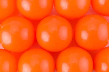 paintball: Orange Paint balls background texture studio shot