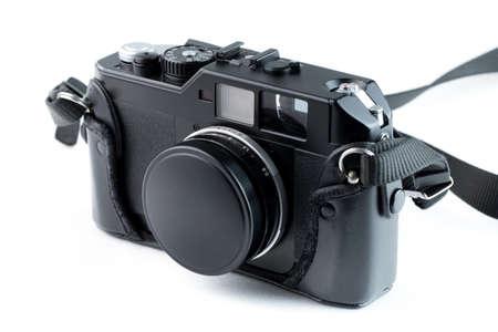 Old vintage rangefinder camera on white background. Studio Shot.