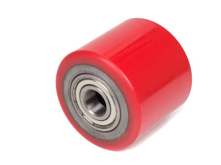 An industrial roller for hoisting equipment made of red polyurethane isolated on a white