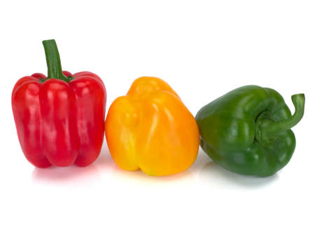 Assorted bell peppers isolated on a white background Imagens
