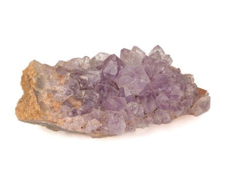 Amethyst crystals close-up on a white background