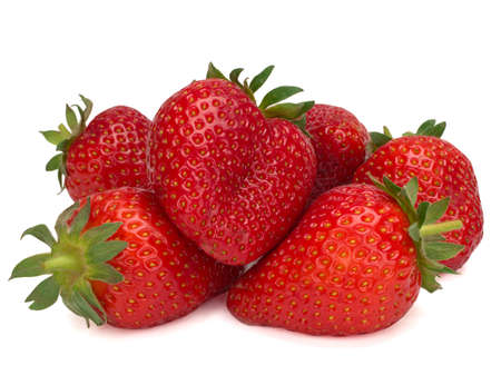 Some isolated strawberries on a white background
