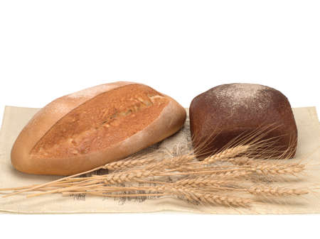 freshly baked bread and ears of wheat on the towel isolated on white background, top view Zdjęcie Seryjne