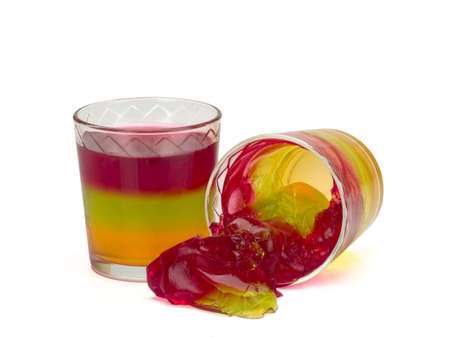 Two glasses with tricolor jelly isolated on white background