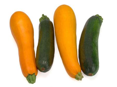 Fresh zucchini in closeup on a white background