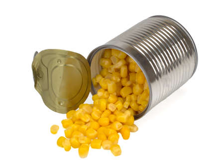 sweet corn sprinkled from a metal can isolated on a white background, Top view