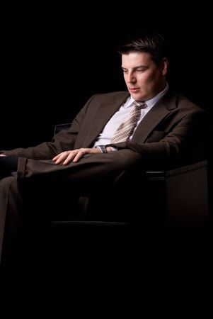 Young businessman sitting on the couch Rich businessman sitting on the couch  photo