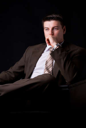 Young businessman think on the couch  photo