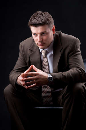 Young businessman sitting on the couch  photo