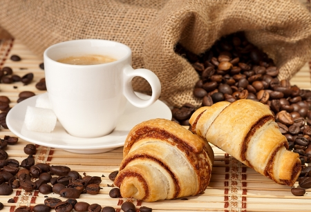 Coffee cup with croissants  photo