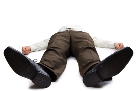 lying down on floor: Young businessman lying on the floor