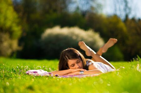 Young Woman sleep on beautiful green grass photo