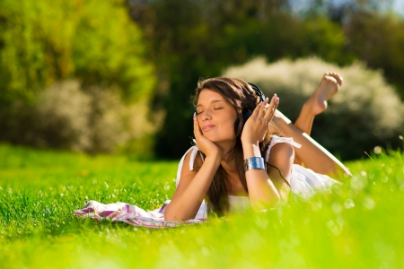Beautiful Young Woman with Headphones Outdoors photo