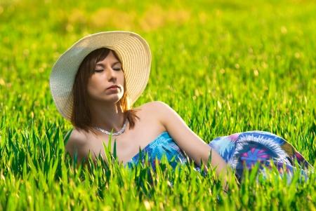 Beautiful girl relaxing on a meadow  photo