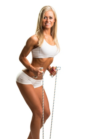 vigorous: Young woman with skipping rope isolated on white Stock Photo